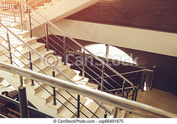 Staircase in modern buisness center building. Emergency evacuation exit. Stairs in shopping center. White ladder - csp66491675