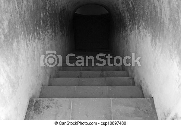 Staircase leading to dark tunnel - csp10897480
