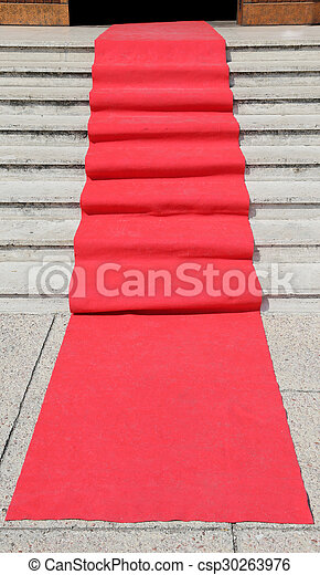 staircase with red carpet and the access door open - csp30263976