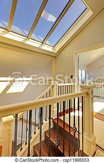 Staircase with skylight and baby room. - csp11906553
