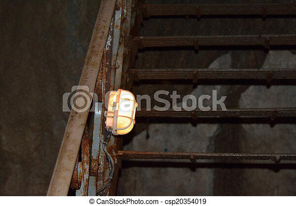 Stairs with a lamp in the cave - csp20354019
