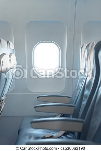Standard, coach passenger seats and window on a commercial airliner aircraft. - csp36063190
