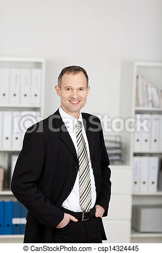 Standing businessman standing at the office - csp14324445