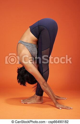 Standing Forward Bend yoga asana - csp66490182