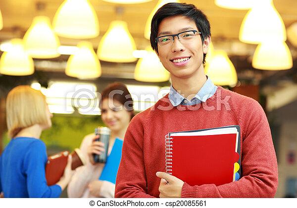 standing, giovane, asiatico, ritratto, felice, università, uomo - csp20085561
