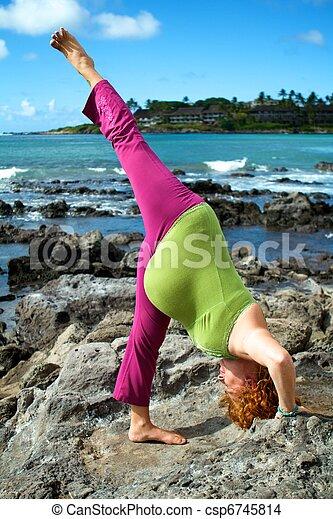 standing split pregnant woman in a standing split yoga