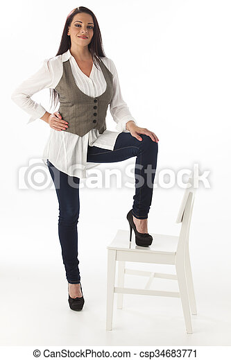 standing woman with a chair - csp34683771