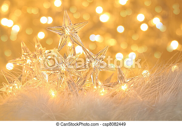 Star holiday lights with sparkle background - csp8082449
