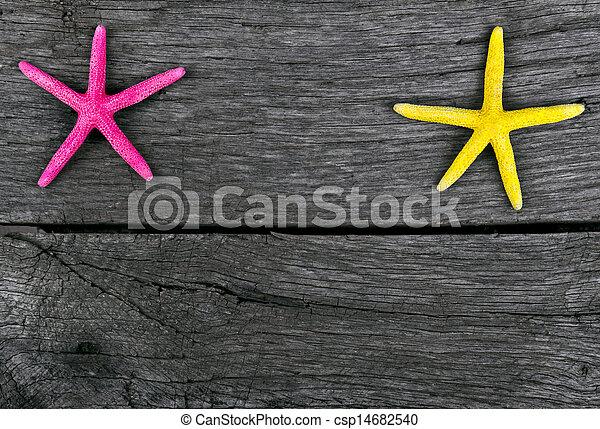 starfish frame on vintage old wood - csp14682540