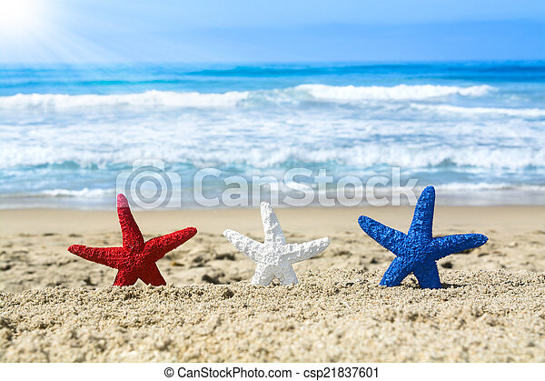 Starfish on beach during July fourth - csp21837601
