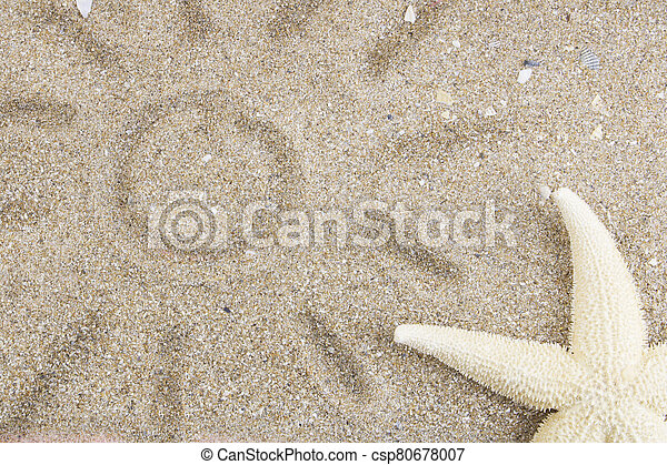 Starfish on golden ocean sand, near the sun drawn by a child on the sand. The concept of tourism, leisure and travel, vacation by the sea. Copy space. Flat lay. Top view. - csp80678007