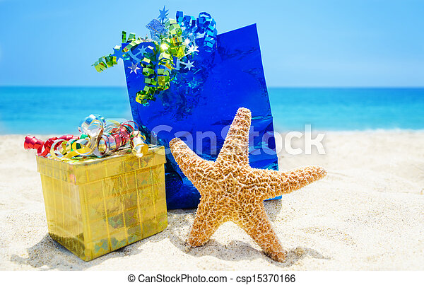 Starfish with gifts on the beach - holiday concept - csp15370166