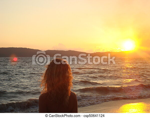 Staring the sunset - csp50641124