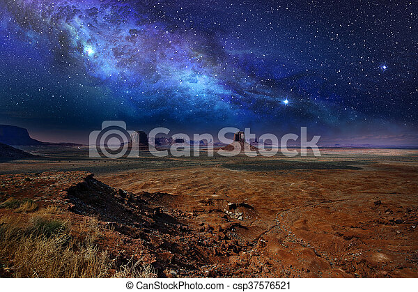 starry night sky over the monument valley - csp37576521