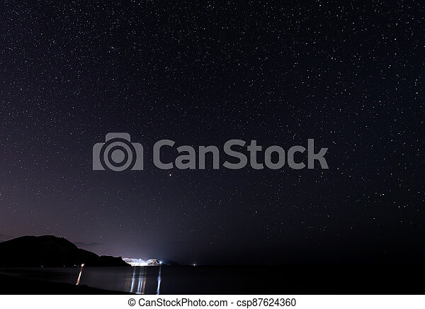 Starry sky over the mountains at night in summer. - csp87624360