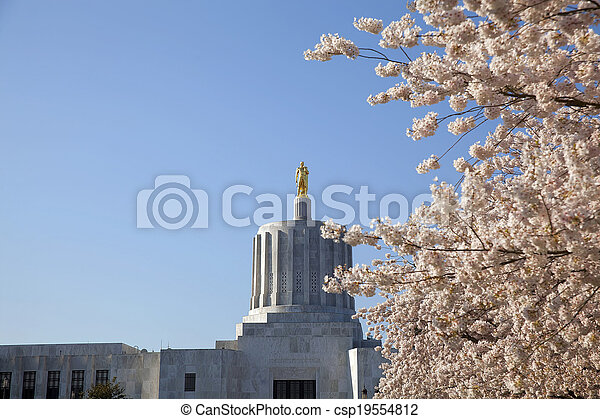 State of Oregon Capitol with Golden Pioneer Statue - csp19554812