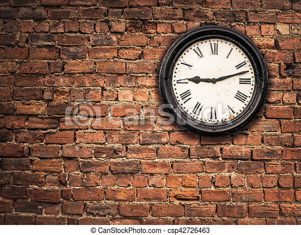 A Vintage Station Clock On A Red Brick Wall With Copy Space Canstock