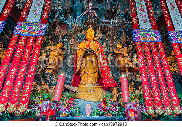 statue in the The Jade Buddha Temple shanghai china - csp13972915