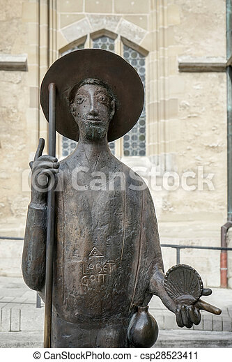 Statue of a man outside St James Church in Rothenburg - csp28523411