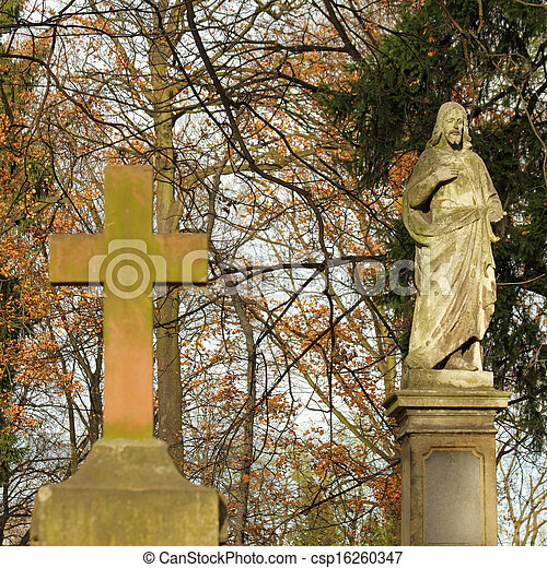 statue  of Jesus on monumental Rakowicki cemetery  in Krakow in autumnal colors - csp16260347