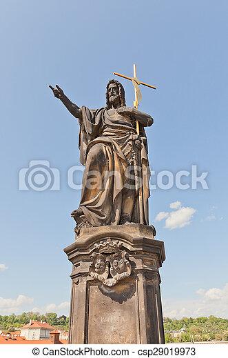 Statue of St. John the Baptist on Charles Bridge in Prague - csp29019973