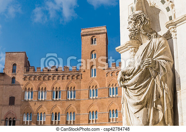 Statue of the Cappella di Piazza and Sansedoni Palace. Siena, Tuscany. Italy - csp42784748