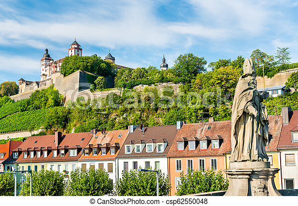 Statue on the Alte Mainbrucke and Marienberg Fortress in Wurzburg, Germany - csp62550048