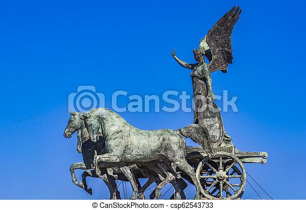 Statue Quadriga dell'Unita on Vittoriano in Rome, Italy - csp62543733