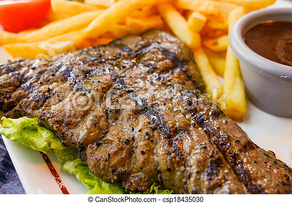 steak beef meat with tomato and french fries - csp18435030