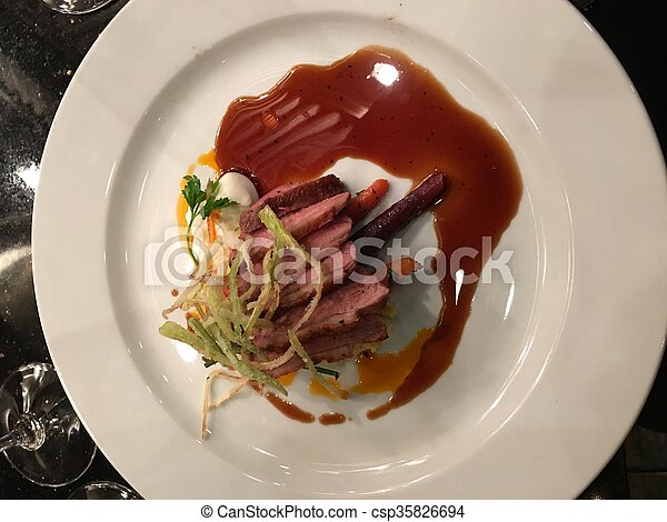 Steak fine dining. Strips of steak played with carrots and ...
