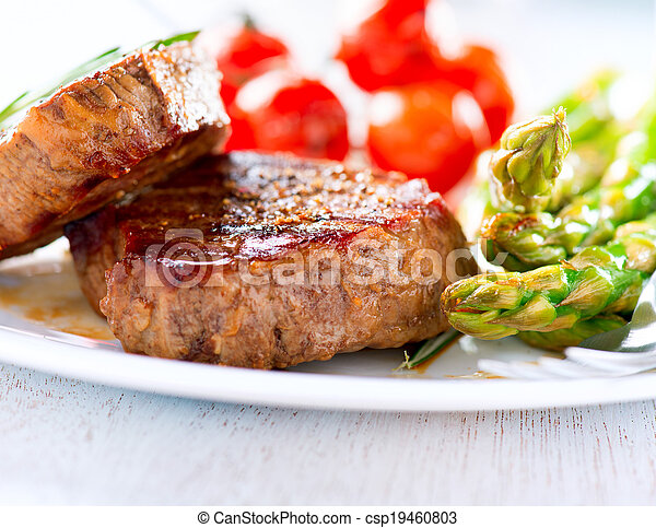 Steaks. Grilled Beef Steak Meat with Vegetables - csp19460803