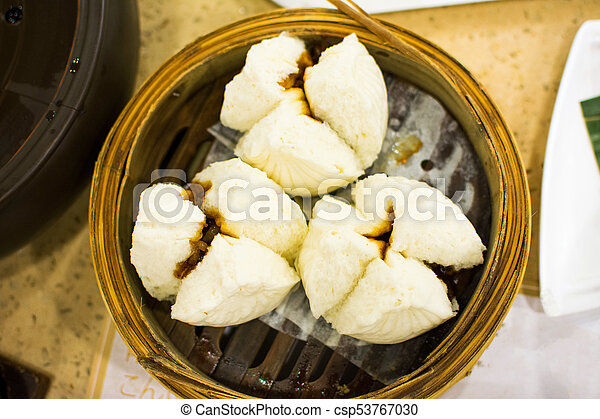 steamed bun with barbecued pork served on bamboo steamer in stock