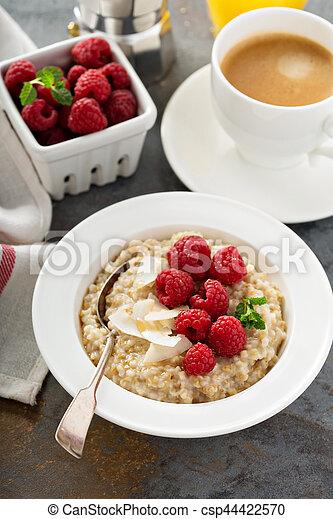 Steel cut oatmeal porridge with raspberry and coconut - csp44422570