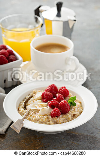 Steel cut oatmeal porridge with raspberry and coconut - csp44660280