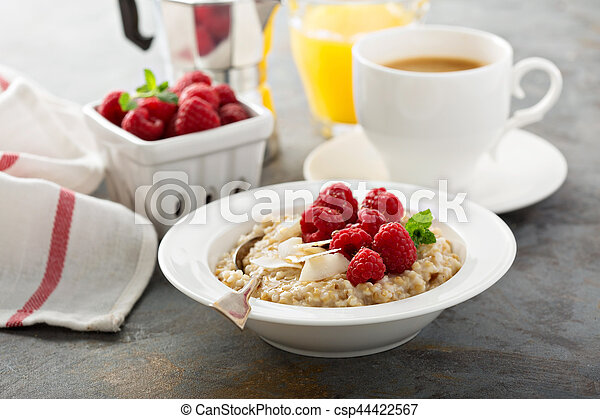Steel cut oatmeal porridge with raspberry and coconut - csp44422567