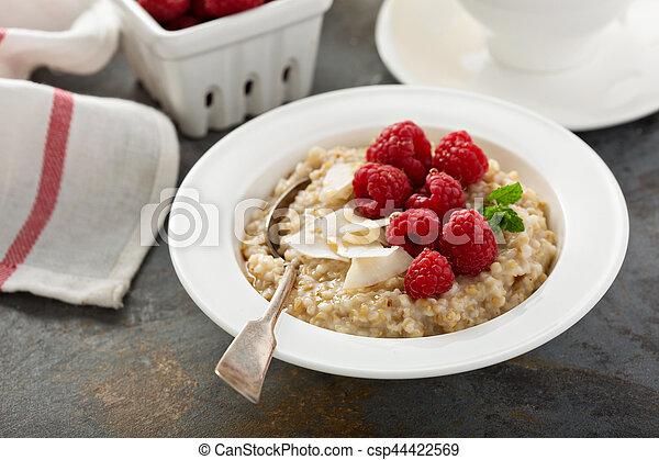 Steel cut oatmeal porridge with raspberry and coconut - csp44422569