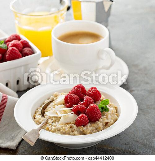 Steel cut oatmeal porridge with raspberry and coconut - csp44412400