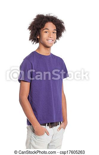 stehende , junge, jugendlich, besitz, heiter, afrikanisch, junger, freigestellt, teenager., während, taschen, hände, lächeln, weißes - csp17605263