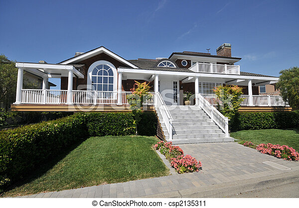 Steps lead to a house with pillars and railings. grass,... stock ...