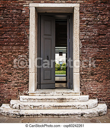 Steps to open door, doorway in old brick wall. Concept: way to the future, new opportunities - csp60242261