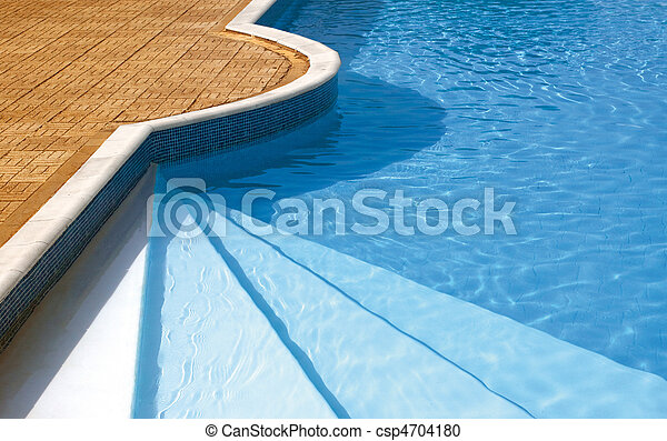 Steps to the swimming pool. Rippled water under sunlight - csp4704180