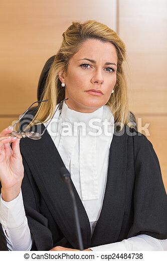 Stern judge looking away  - csp24484738