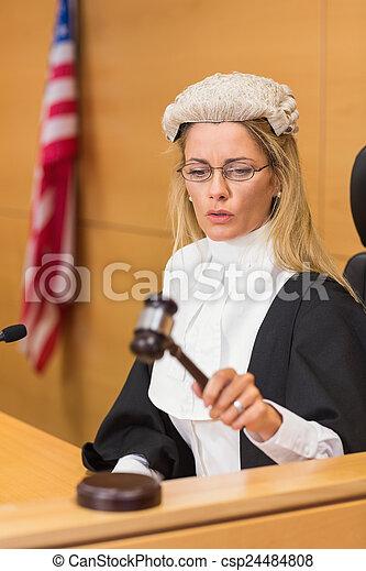 Stern judge sitting and listening - csp24484808