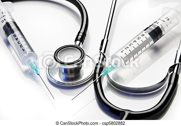 Stethoscope and syringes - csp5802882