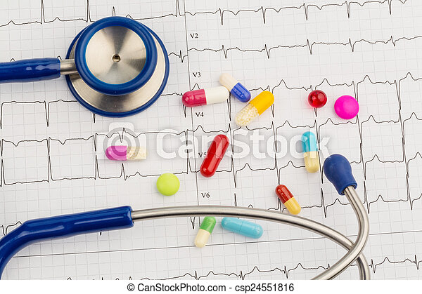 stethoscope and tablets on an ecg - csp24551816