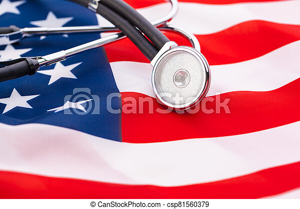 Stethoscope on American national flag, close up. creative photo. - csp81560379