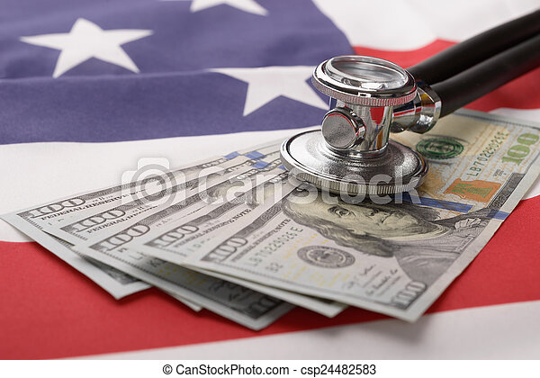 Stethoscope On Us Currency And American Flag - csp24482583
