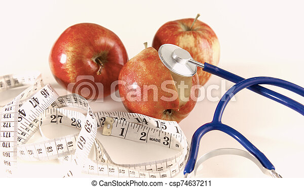 Stethoscope with red apples on a white background - csp74637211