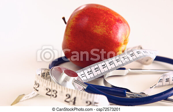 Stethoscope with red apples on a white background - csp72573201