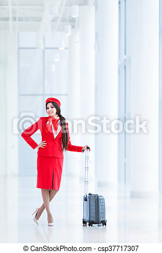 Stewardess with luggage - csp37717307
